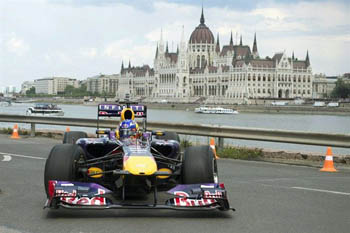 an F1 race car of the Red Bull team on the Danube bank in Buda