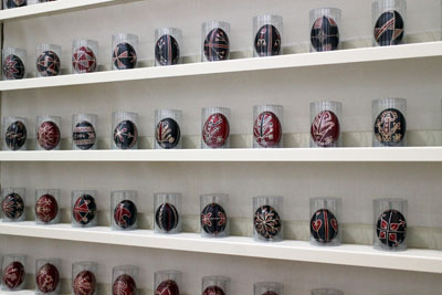 red and blue Easter eggs with various motifs painted on them