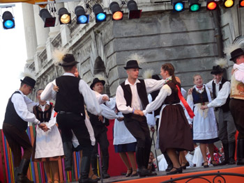 a folk dance ensemble on the stage of the festival