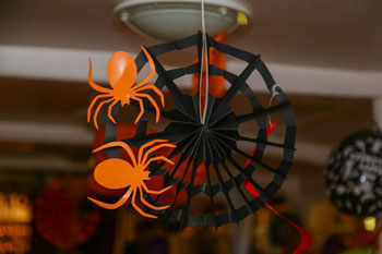 orange and black paper spider decoration