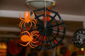 orange and black paper spider decoration