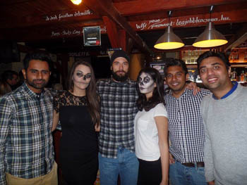 4 guys and 2 girls in a club, the girls wear Halloween makeup