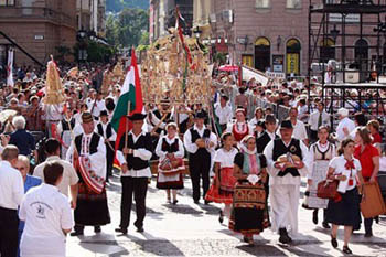 people in folk costumes on the Harvest Procession