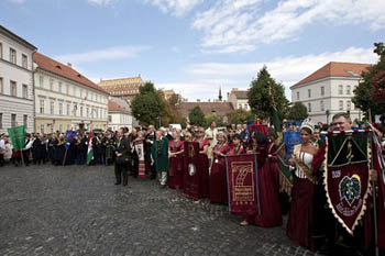 a procession of people dressed in folk costume or other special uniform