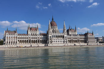 view of the Parliament from a boat on the Danube