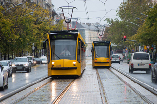 two yellow Combino trams