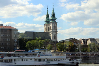 the two towers of St. Anne Church photographed from a boat on the Danube