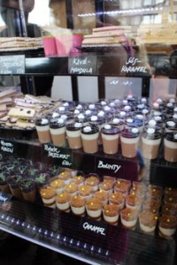 various shot glass desserts behind a counter
