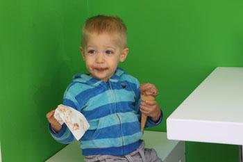 son enjoying his icecream in MAMO