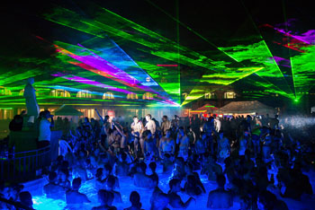 outdoor bath party with green, blue, purple light show