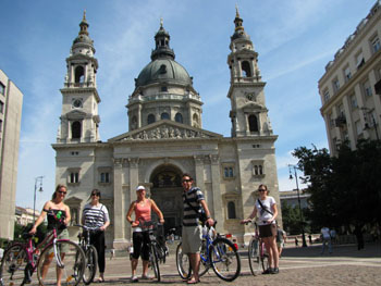 people on a bike tour in front of the Basilica in Pest