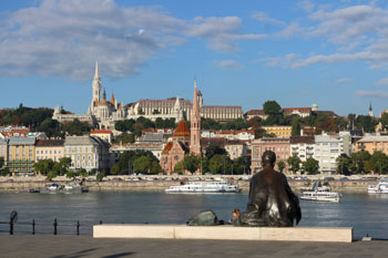 the bronze statue of Attila Jozsef poet from behind on the Pest Danube bank