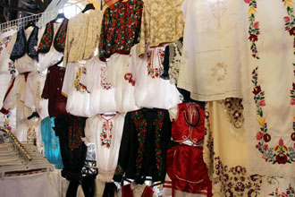 Embroidered folk textiles on the upper level of the Central market