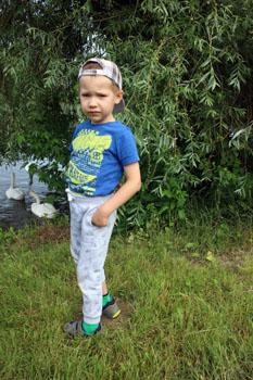 our 5 yr old boy feeding the swans in the Danube