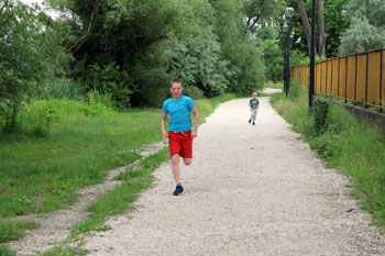 our 12 yr and 5 yr old boys running on the path at the Banube bank in Csepel