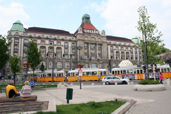 Gellert Sqr with the yellow tram 49 in front of it.