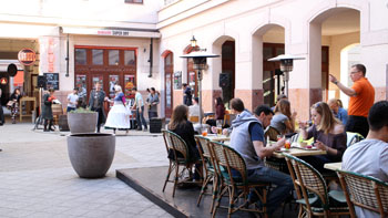 people on the terrace of a restaurant in Gozsdu Court