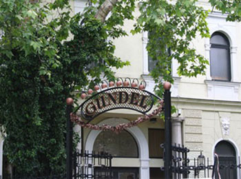 the wrought iron entrance gate of Gundel