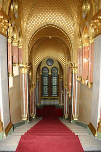 a red carpeted staircase