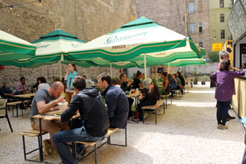 people eating at wooden tables in Karaván