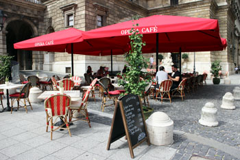 the Opera cafe's terrace with red tents above the tables