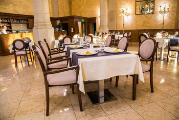 the elegant interior of the Pesti vigado resturant with white clothed tables