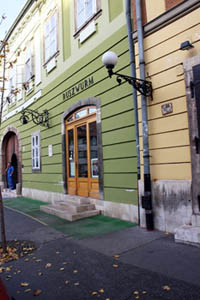 the green facade of the cake shop