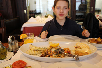 our older son eating seafood in Trattoria Pomo D'oro