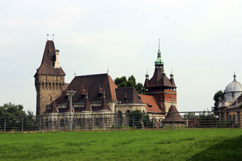 the castle with a green lawn in the foreground