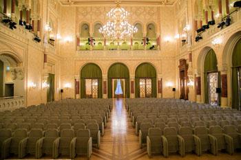 beige seats, large chandelier in the concert theatre