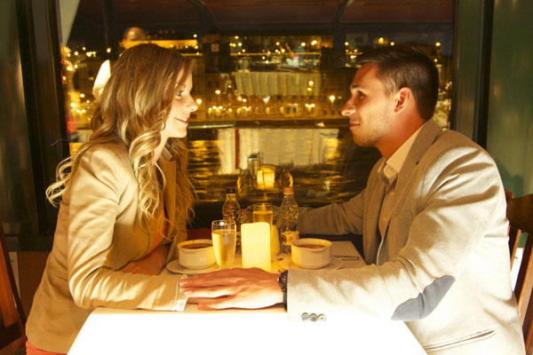 a young couple having a romantic dinner a cruise boat on the Danube
