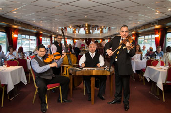 a gypsy folk orchestra playing on board a ship