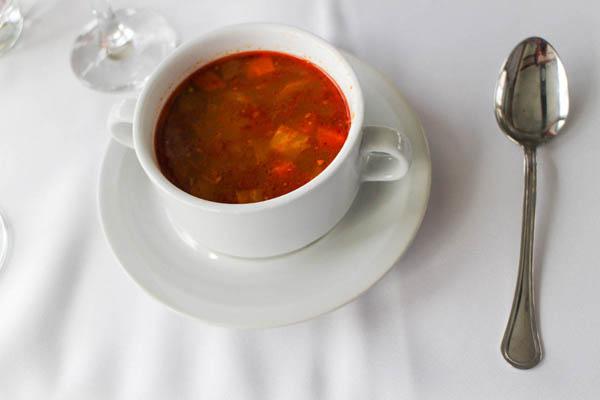 goulash in a white soup bowl