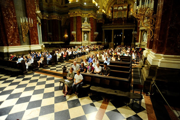 people on a concert in the main nave of Budapest's Basilica