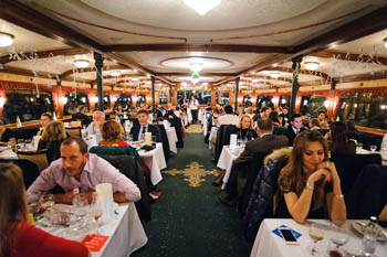 people on the Europa ship having dinner,