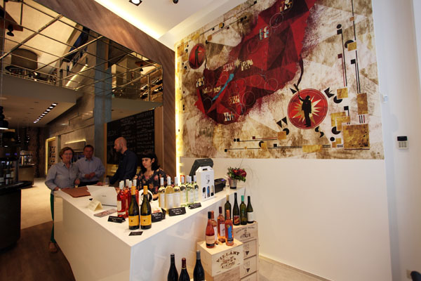 The modern interior of the wine gallery red map of the local wine regions on the wall