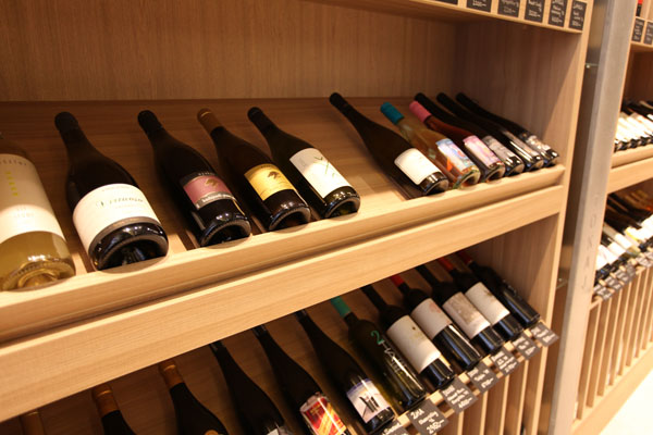 a dozen of bottle of wines two wooden shelves