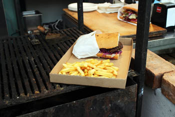 burger with fries on a cardboard tray