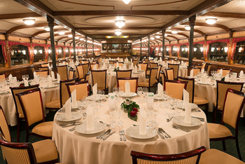festively laid round tables onboard the ship