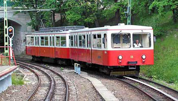 a red and white cogwheel tram