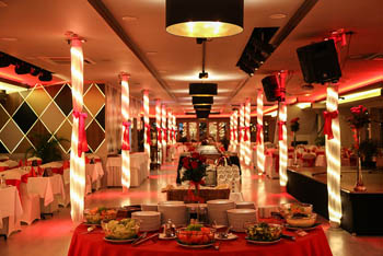 boat resturant decorated in red and gold for a romantic evening