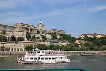 a whiet sightseeing boat on the Danube at Buda castle
