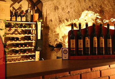 racked wine in a stone cellar