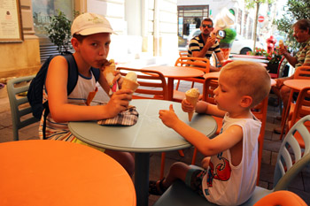 our 11 year old and 4 year old son having ice cream on the terrace of Pomo D'oro