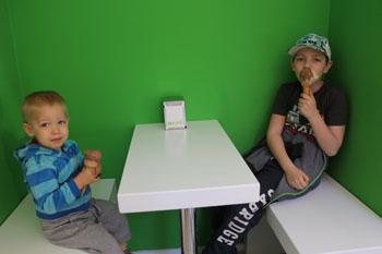 are two kids enjoying their ice cream in MAMo