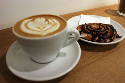 flat white with cocoa snail