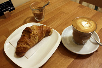 flat white and croissant in Madal Espresso Shop