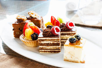 Selection of mini cakes on a white plate