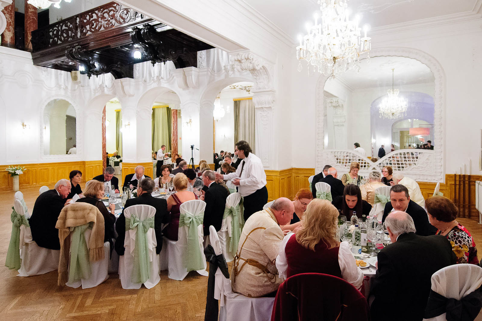 guests seated at a festive dinne rin Danube Palace