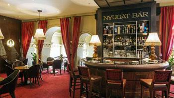 wine red carpet and a dark wood bar in Nyugat bar